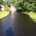 Photo of driveway sealcoating job in Duluth, Mn.